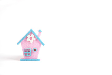 Spring pink and blue house with white flower made of felt on whi