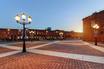 Obraz Centrum handlowe w Łodzi o zachódzie słońca - fototapety do salonu