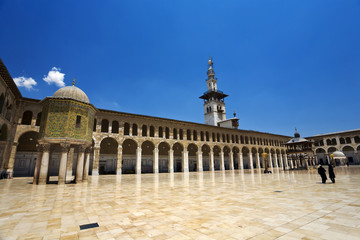 Syria. Damascus. Omayyad Mosque - northern part of courtyard with the Dome of the Treasury on left side and the Minaret of the Bride in the middle