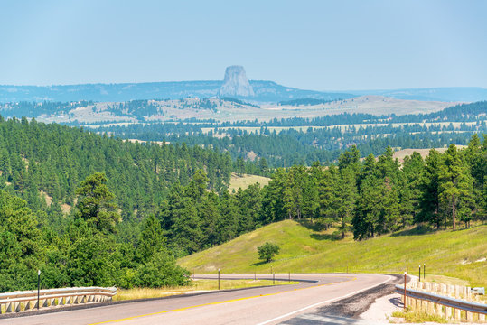 Highway in Wyoming with Devils Tower National Monument visible in the background