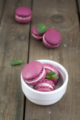 Sweet crimson french macaroons in white plate