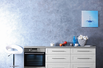 Modern kitchen furniture in the grey interior