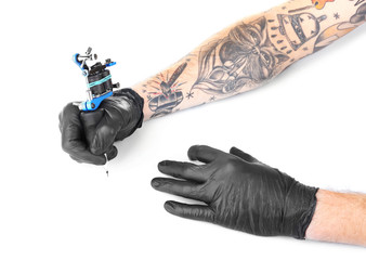 Tattooist hands in black gloves with tattoo machine isolated on white background, close up