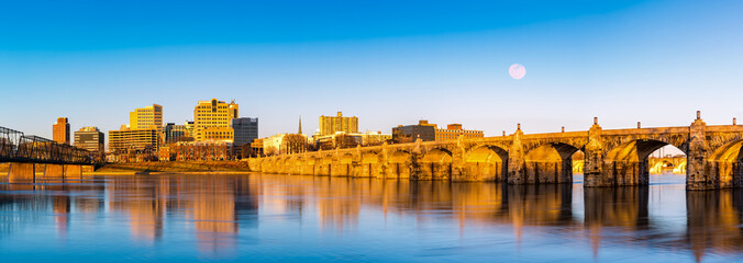 Harrisburg, Pennsylvania skyline with the historic Market Street Bridge reflected on the Susquehanna River at sunset