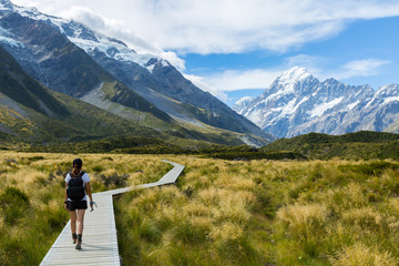 Woman hiker hiking on Hooker Valley Track