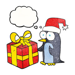 thought bubble textured cartoon christmas penguin with present