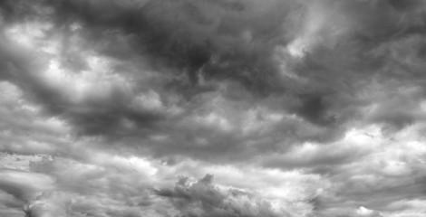Thunderclouds over horizon, panorama, gray. Storm sky, rain.