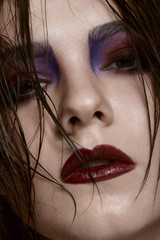 Woman with wet hairs and make up