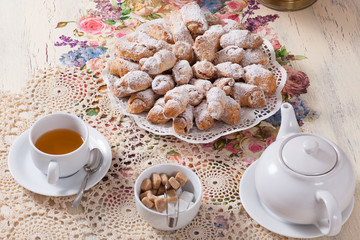 beautifully decorated table with tea and biscuits