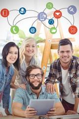 Composite image of portrait of smiling business people using digital tablet