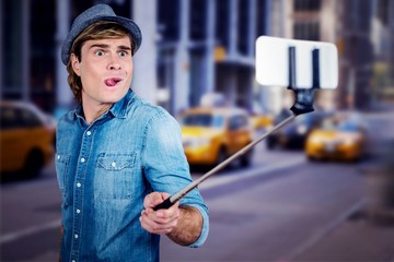 Composite image of funny hipster taking picture