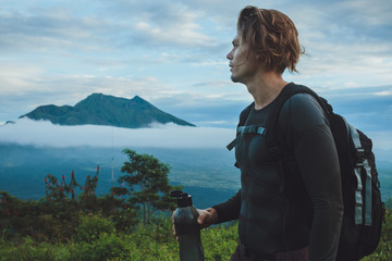 Outdoor portrait of Young man looking on Batur volcano and Agung Fototapete