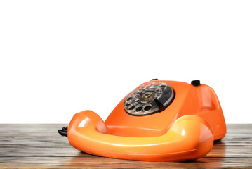 Vintage telephone on desk with isolated background