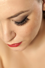 Portrait close-up on a woman's face - artificial eyelashes