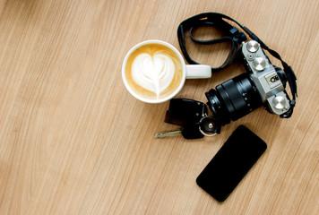camera cellphone key and latte art