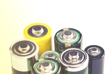 Stack of different used batteries