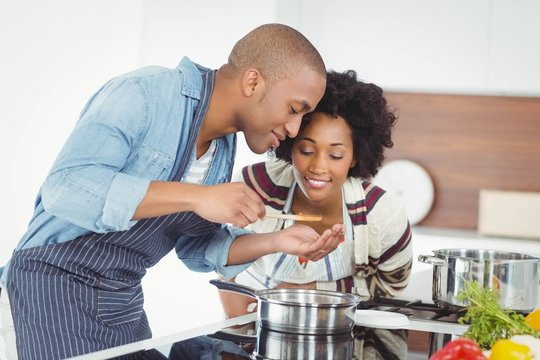 Happy african american couple cooking together