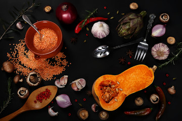 Сomposition of vegetables and cereals on a black background