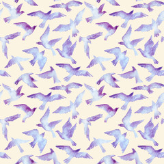 Watercolor silhouettes of flying birds. Seamless pattern