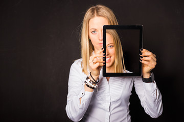 Woman holding tablet with her dual face