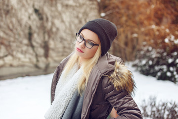 Portrait of fashionable hipster young woman at winter