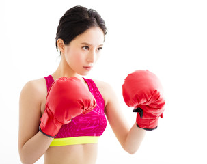 fitness young woman  wearing red boxing gloves