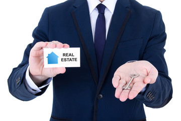 key and visiting card in male real estate agent hand isolated on