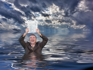 Senior man holding IRS form 1040 in water