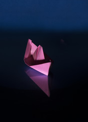 pink paper boat