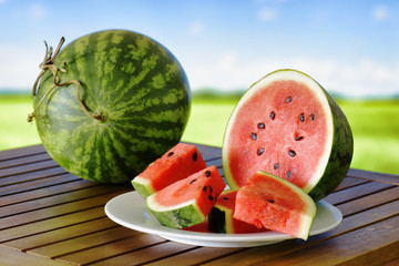 Fresh ripe juicy watermelon on wooden table