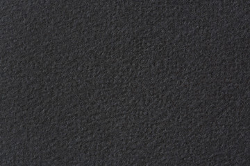 Textured (paper) background in dark gray colors.