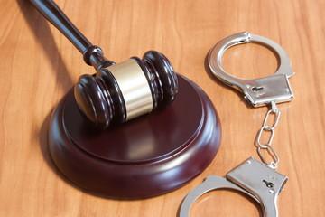 Judicial hammer and handcuffs