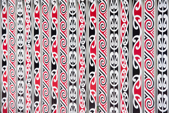 painted Maori decorations on the fence in Rotorua, New Zealand