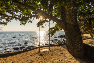 Swing on a beautiful beach at sunset. Koh Chang. Thailand.