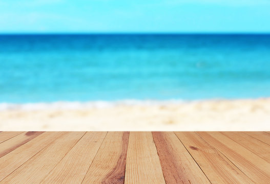 Wood table on blurred beach background