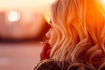 Woman Smoking at Sunset