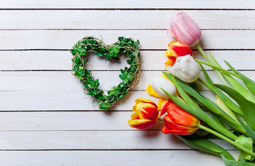 bouquet of tulips and heart shape gift