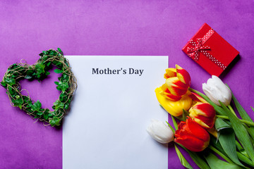 tulips and paper with words Mothers day