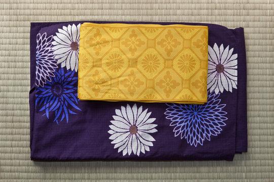 Folded yukata and obi, a light robe and sash belt in Tokyo, Japan