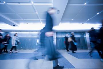London businessman train tube station in rush hour