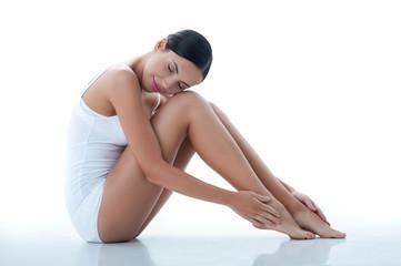 Cheerful slim girl is enjoying skincare treatment