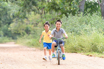 Boy riding bicycle on the road.