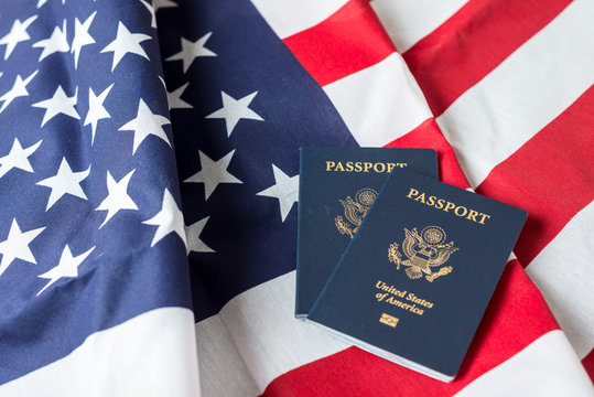 American flag with American Passports