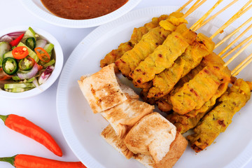 Traditional Thai style, Grilled pork satay with peanut sauce and toast.