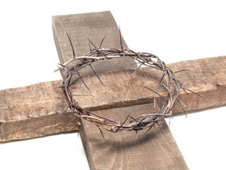 Crown of thorns on a wooden cross isolated on white