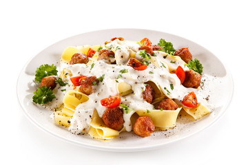 Pasta with meatballs and cream sauce