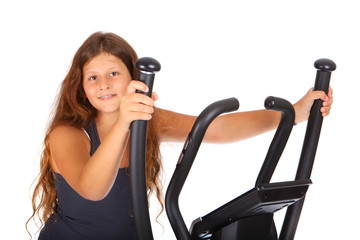 Little girl with elliptical trainer