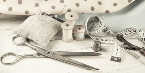 Set of reel of thread, scissors, fabric and pins for sewing and