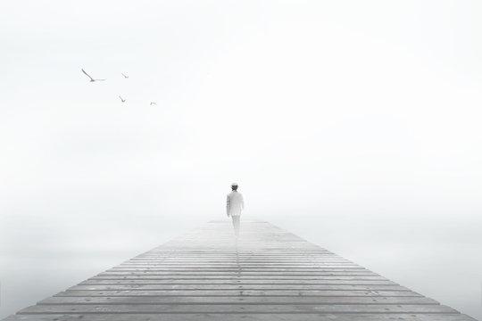 Man desappearing in the white fog