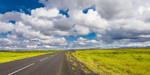 Isolated road and Icelandic colorful landscape on Iceland, summe